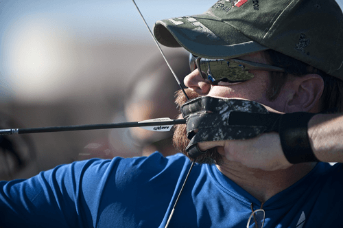 man aiming a target in archery
