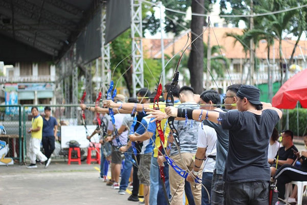 archery competitors in a line